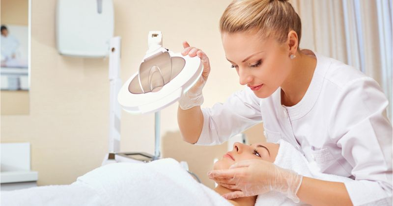 Esthetician doing a facial